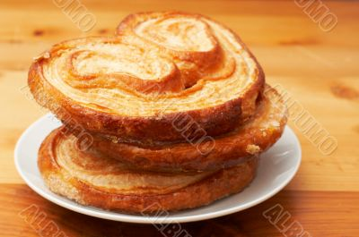 Palmier pastries on white saucer