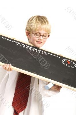 boy plays with black board