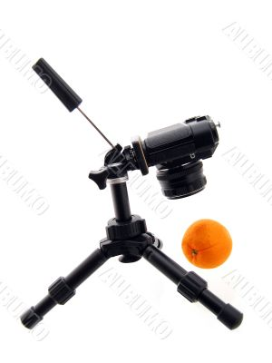 Photographing of orange. Tripod and camera