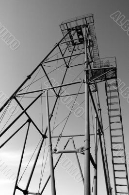 The thrown old rusty oil derrick