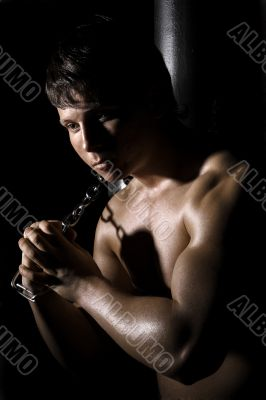 Muscular man with chain