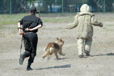 Policeman and dog.