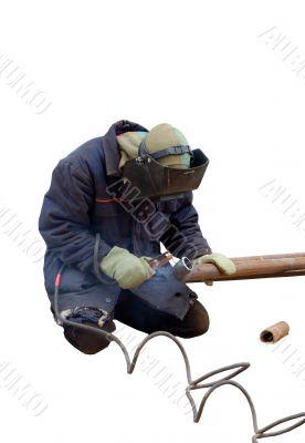 man cutting a pipe