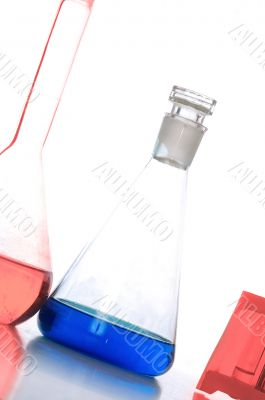 three chemical glass with blue and red liquids