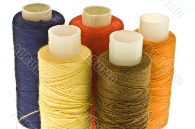 five spools of thread