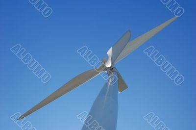 looking up a wind turbine
