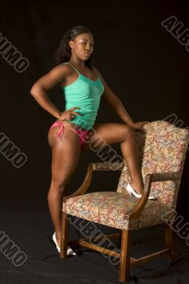 Sexy African-American girl by chair