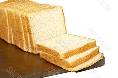 Slices of bread on plank