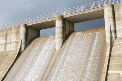 Dam water to generate energy