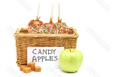 candy apples in a basket for sale