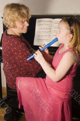 grandmother and grandchild enjoying making music together