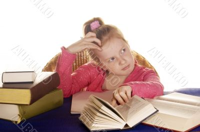 young little girl thinking over her study