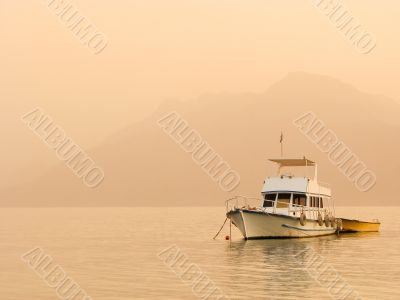 Alone boat at silent water /