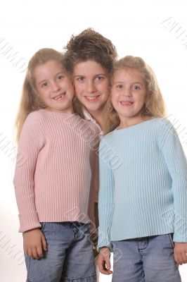Three siblings on white vertical