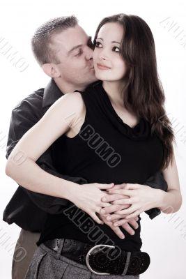Man is kissing his girlfriend