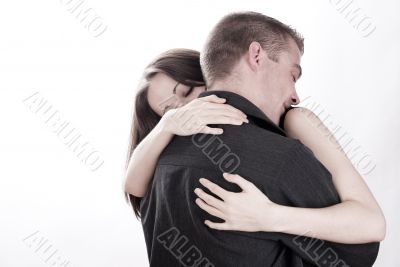 Man is holding his girlfriend