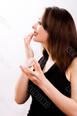 Cosmetic girl is touching her lips