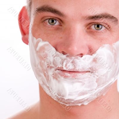 Shaving young man