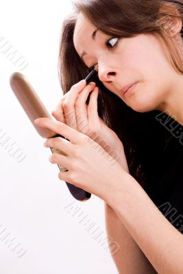 Cosmetic girl touching her eyes