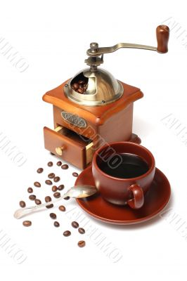 old coffee mill with Beans and cup of coffee