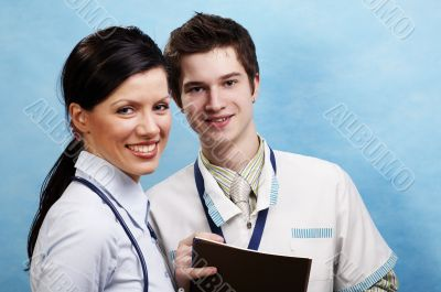 young caucasian doctor with assistant