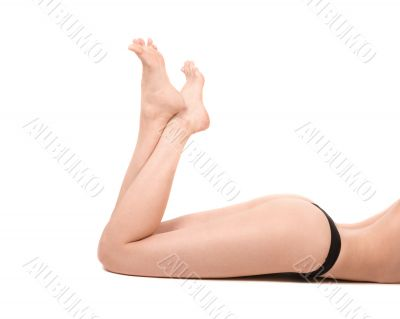 Long legs of relaxed lady in black lingerie