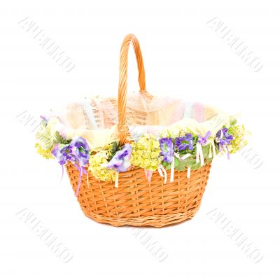 Empty basket with decoration on white