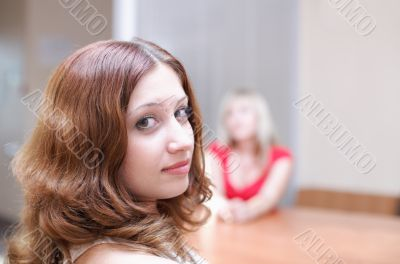 Woman discuss your secret in office