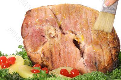 brushing ham with glaze