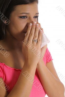 beautiful girl with allergies sneezing