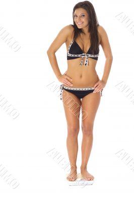 female weighing herself