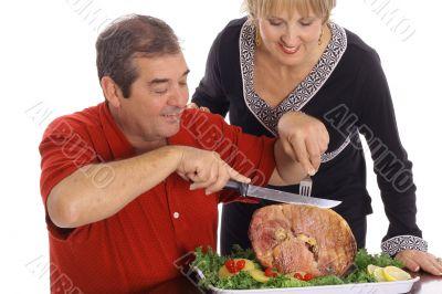 couple slicing ham