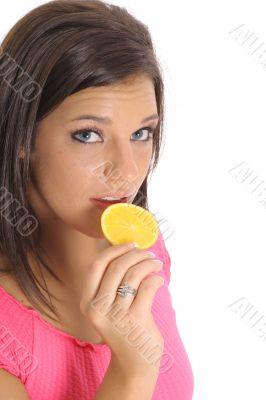 model eating an orange slice