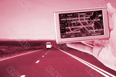 GPS Vehicle navigation system in a man hand.