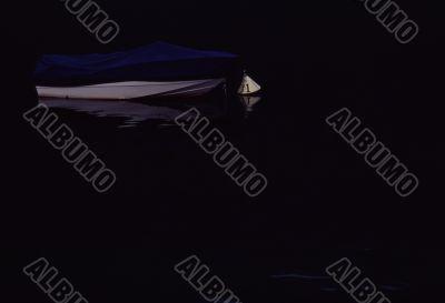 Boat on dark water