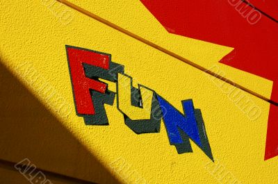 Colorful `FUN` painted on wall