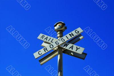 Crossed signs reading `Railway Crossing`