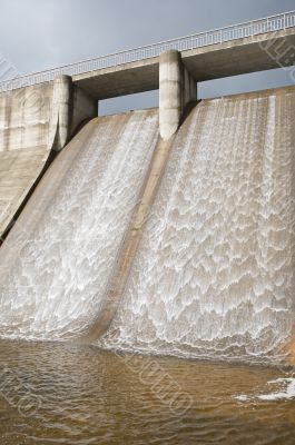 Dam water to generate energy
