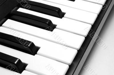 small synthesizer keyboard closeup