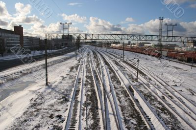 Railway tracks cover by snow in winter