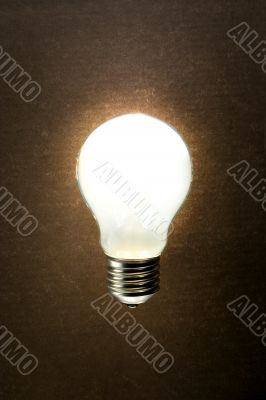 Bright lamp on a textured background