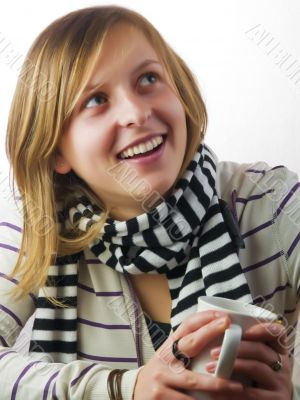 Girl drinking coffee and smiling
