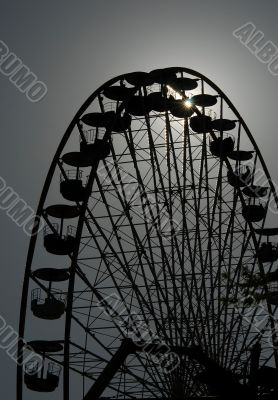 Big wheel in the evening against the sun