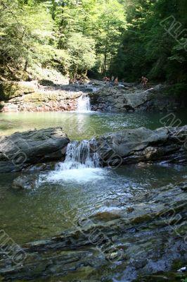 bathing in small waterfalls in granite coast