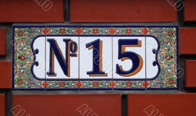 House number tile plaque with floral ornament