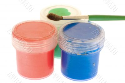 jars with paint of three colors