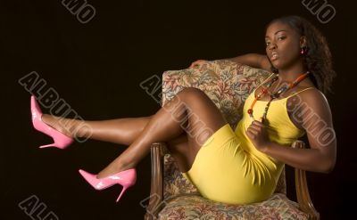 Glamorous African-American girl in chair