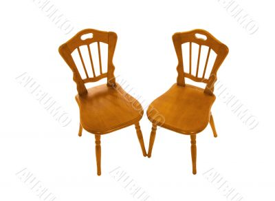 Two wooden chairs isolated on a white