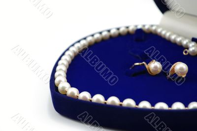pearl necklace in blue heart-shaped box