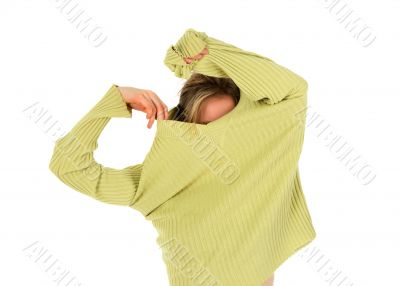 Funny girl takes off a green sweater